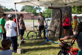 Back Alley Bikes offering a bike maintenance class during the Northwestern Detroit Market