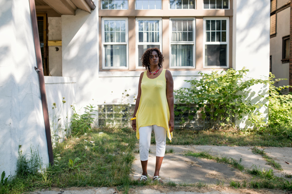 Arleen Alan Hunter in front of her home, which she lost in Wayne County's 2014 tax auction