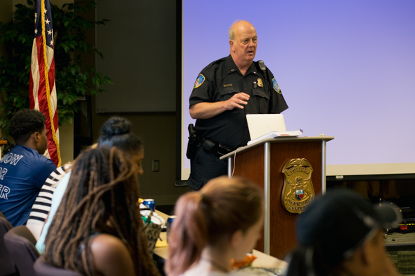WSU police officer speaks to the students attending the workshop at the WSU Police Department