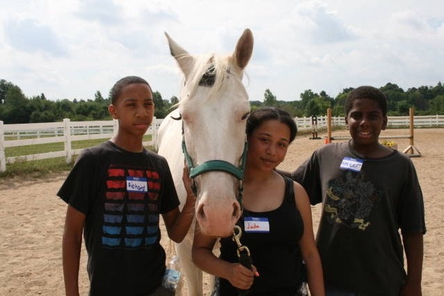 Richard, Jada, and Ameer interact with a Dewey (horse) through Detroit Horse Power