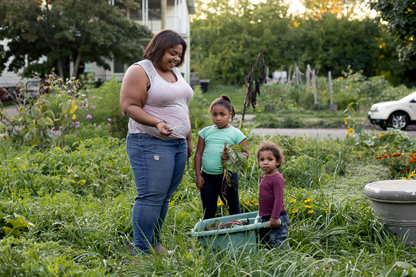Erin Cole, co-owner of Nurturing Our Seeds, with her two children, Oshun and Asa