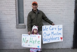 Man and child attending Hamtramck peace rally