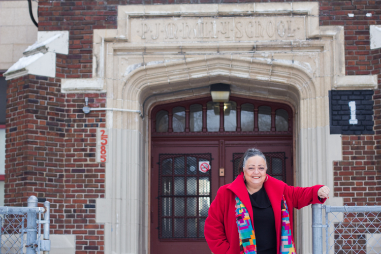 Kearny in front of her old school, now the Paul Robeson/Malcolm X Academy