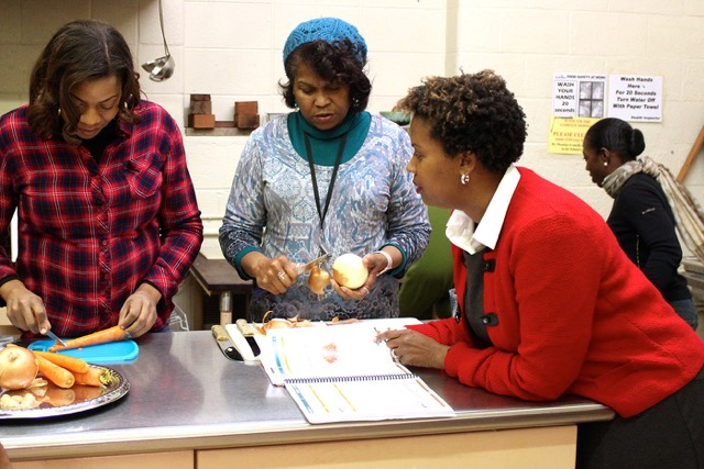 Instructor and nutritionist Winona Bynum (right) calls the shots from the ATOAH recipe book