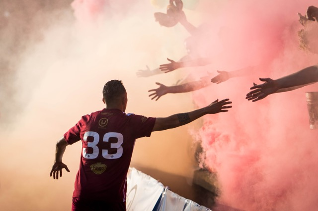 DCFC player high-fives fans through smoke bombs