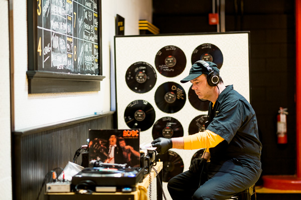 A Third Man worker selecting a record to play for the production floor