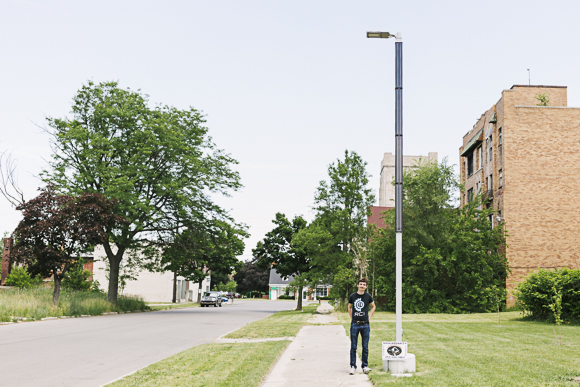 Soulardarity founder Jackson Koeppel next to a solar-powered streetlight