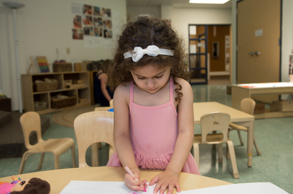 Nala Saab draws at the UM Dearborn Early Childhood Education Center