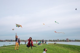 Attendees of a kite pop-up on the riverfront