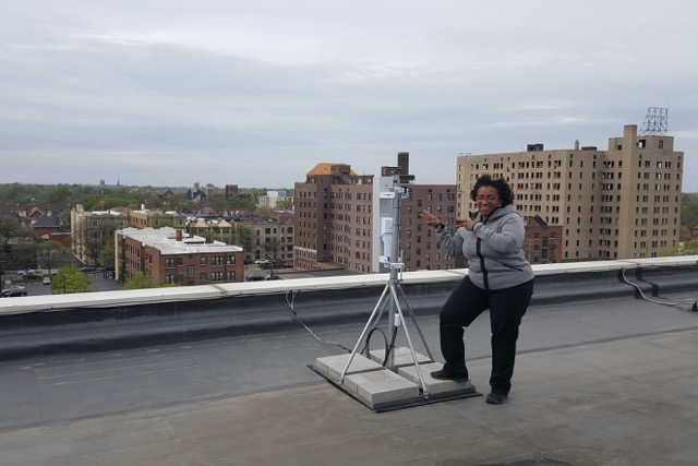 Monique Tate shows off the wireless technology on the roof of WNUC