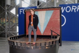 Carleton Gholz stands on the Blue Bird stage at the St. Etienne Biennale