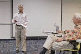 Chase Cantrell, founder of Building Community Value, speaks during a session of Better Buildings, Better Blocks
