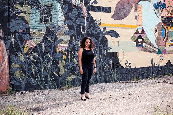 Roula David in front of a mural in Eastern Market