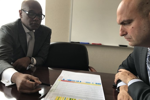 Detroit schools Superintendent Nikolai Vitti consults with Luis Solano, the district's new chief operating officer