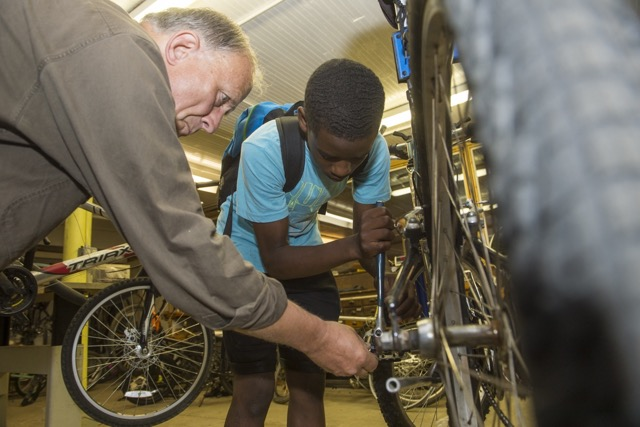 Working on a bike at Church of the Messiah