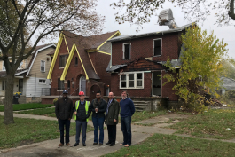 Members of the Tuxedo Project in front of the literary house while the abandoned house next door is demolished