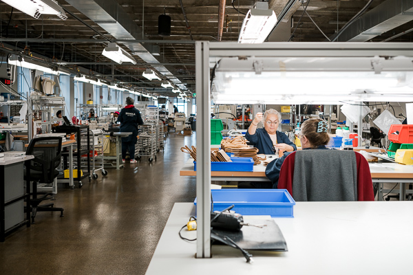 The leather goods floor at Shinola's factory space in New Center
