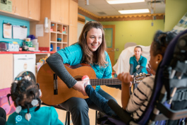 Blythe Filar plays music with patients