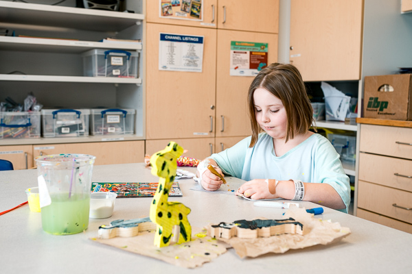 A child patient in an art therapy session