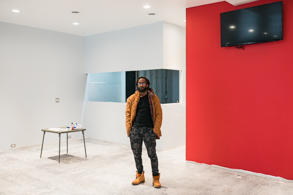 Corey Williams inside his company's 8,000 square-foot mixed-use development