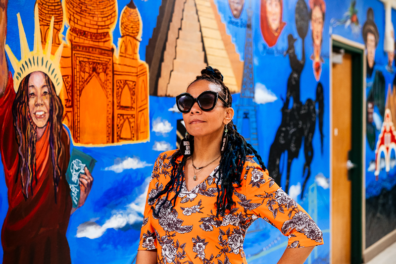 "jessica care moore in front of the ""Unity Mural"""