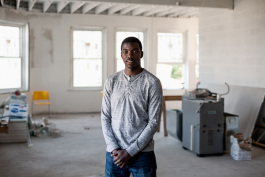 Ezekiel Harris, executive director of MACC Development, inside what would become The Commons, a community space, coffee shop, and laundromat (June 2017)