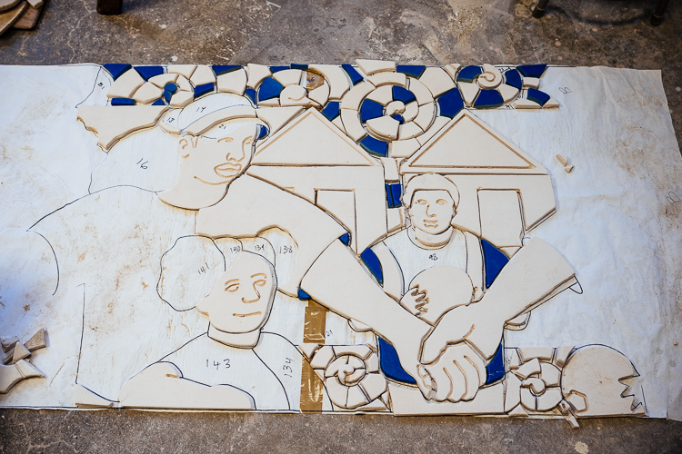 "Creating the ""Hands of Happiness"" mural for Hubert Massey leads locals in creating a mural for Ella Fitzgerald Park"