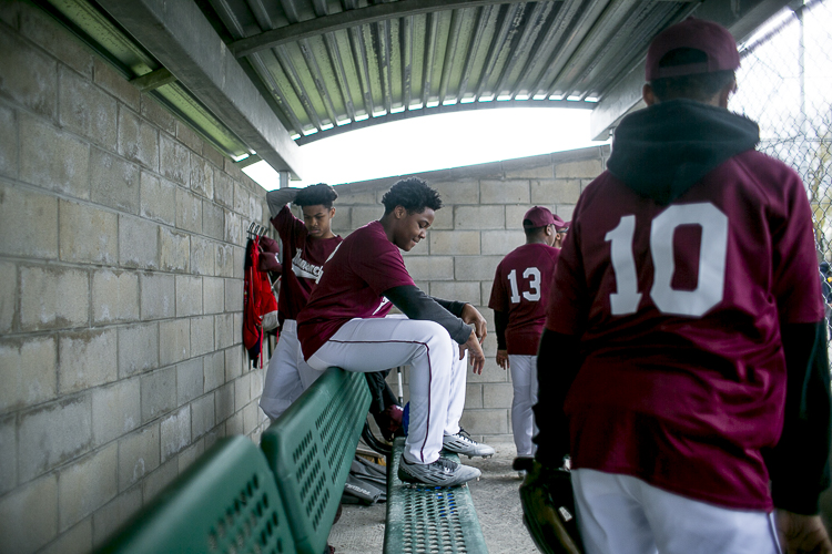Players sit in the dugout at Stoepel Park Park No. 1