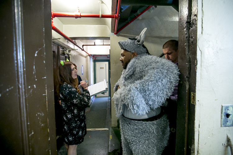 Jonathan Jones puts on his Donkey costume before a before a performance of Shrek: The Musical