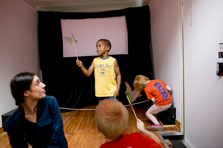 Children play with shadow puppets before a performance from CMAP