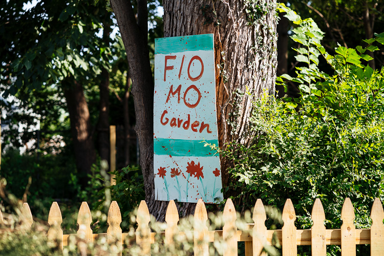Painted sign at Mo-Flo Community Garden