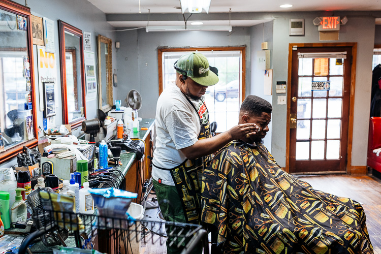 David Hardin Jr. cuts a customers hair