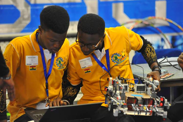 Two international students prepare their Robot during Robofest