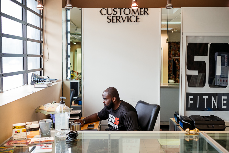 Bear Sanusi at SOS Fitness front desk