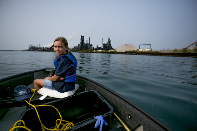 Jessica Speiss rides in her dad's boat in during a Trash Fishing outing near Zug Island