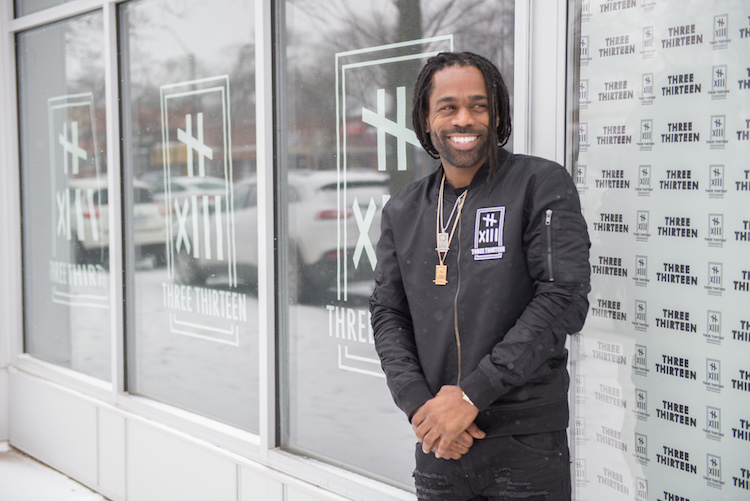 "Clement ""Fame"" Brown Jr., owner of The Three Thirteen, outside the store's new location on Livernois"