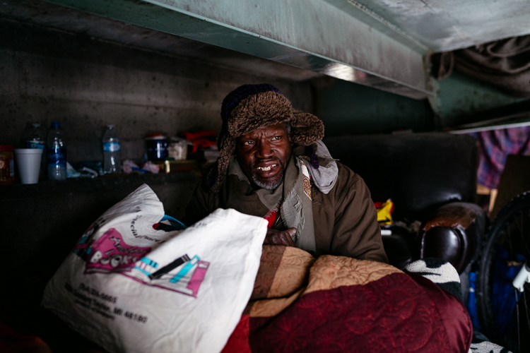 Curtis Farr, 58, has been living under the pedestrian bridge (the opposite side from Loy) for over a year. Carpenter put in an order at a pharmacy for his high blood pressure medication.