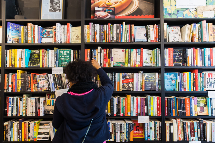 A River Rouge student browses the fiction section at Pages Bookshop