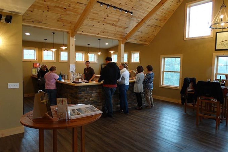 Customers taste the wine at Petoskey Farms Vineyard & Winery