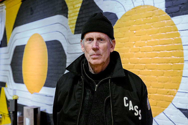 Robert Sestok in front of his mural at Third Man Pressing in the Cass Corridor