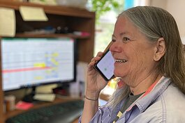 Tri-County Office on Aging volunteer Robin Barfoot makes a friendly reassurance call from her home.