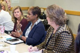 Michigan Department of Education partnership agreement liaison Lisa Francisco; Battle Creek Public Schools superintendent Kim Carter; and Battle Creek Community Foundation president and CEO Brenda Hunt at a Bearcat Meeting.