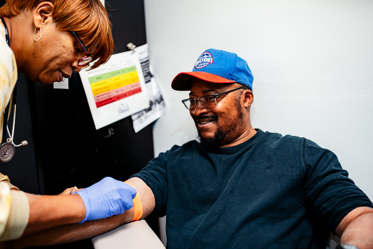 William Butler is prepared to get his blood drawn at HUDA by his nurse, Val Gamble. Butler has been coming to HUDA for his health care needs since he lost his health insurance four years ago.