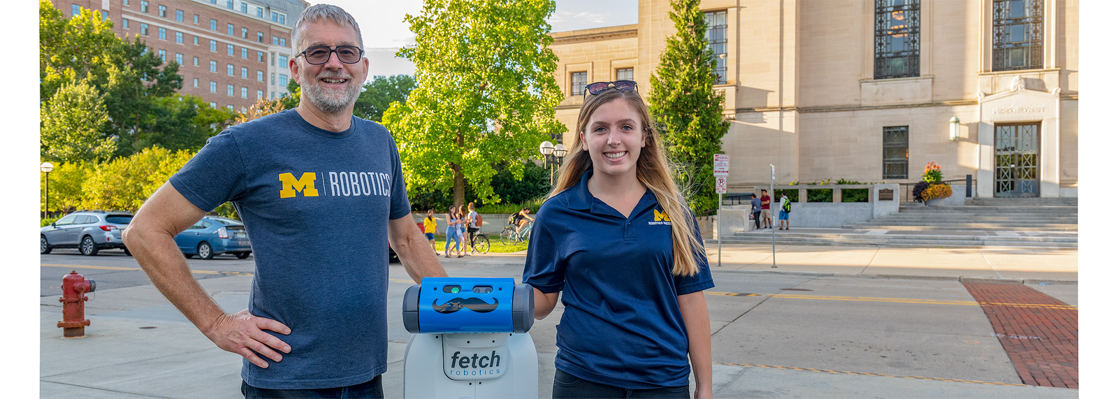 "Jessy Grizzle and Liz Olson of U-M robotics with the robot ""Fetch"" <span class='image-credits'>Doug Coombe</span>"
