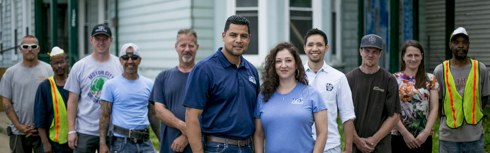Luis Ali and Tanya Saldivar-Ali with the crew of AGI Construction, a southwest Detroit-based construction company